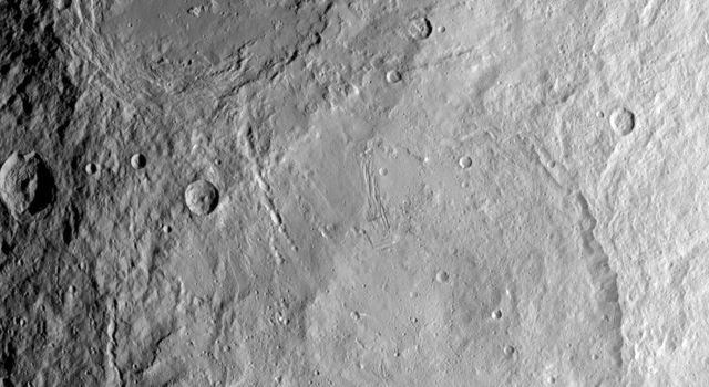 This image from NASA's Dawn spacecraft shows large craters Urvara (top) and Yalode (bottom) on dwarf planet Ceres. The two giant craters were formed at different times. Urvara is about 120-140 million years old and Yalode is almost 1 billion years older.