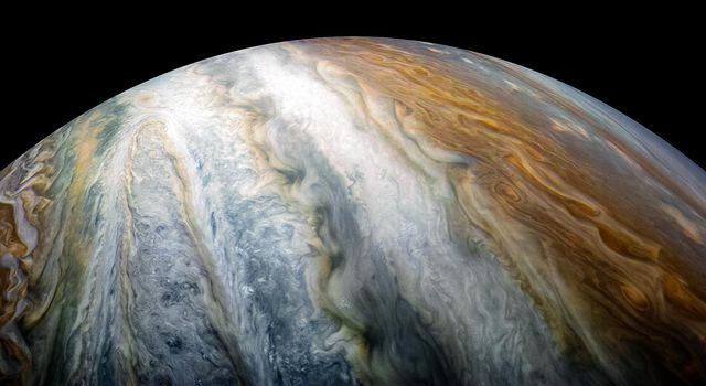 Colorful swirling cloud belts dominate Jupiter's southern hemisphere in this image captured by NASA's Juno spacecraft on Dec 16, 2017.