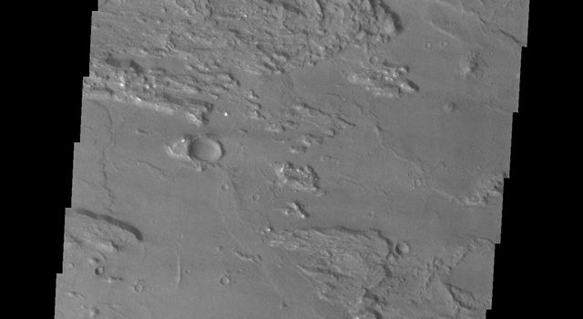 Coprates Chasma is one of the numerous canyons that make up Valles Marineris. This image captured by NASA's 2001 Mars Odyssey spacecraft is located in central Coprates Chasma.