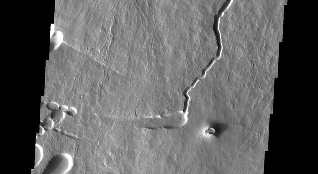 This image captured by NASA's 2001 Mars Odyssey spacecraft shows part of the southern flank of Pavonis Mons. Several faults run from the left to the right side of the image.