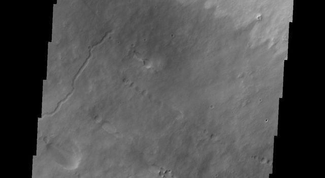 This image captured by NASA's 2001 Mars Odyssey spacecraft shows the southern flank of Pavonis Mons. Pavonis Mons is one of the three aligned Tharsis Volcanoes.