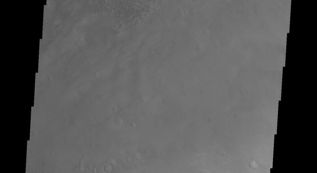 This image of Moreux Crater shows part of the central peak and sand dunes on the crater floor surrounding the peak. The crater rim is at the bottom right of this image from NASA's 2001 Mars Odyssey spacecraft.