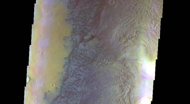 The THEMIS camera contains 5 filters. The data from different filters can be combined in multiple ways to create a false color image. This image of Moreux Crater from NASA's 2001 Mars Odyssey spacecraft shows the western floor of the crater.