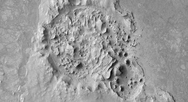 This image from NASA's Mars Reconnaissance Orbiter shows a crater is located in Elysium Planitia, Mars, an area dominated by volcanic processes. It is likely that the crater fill material is volcanic in origin.