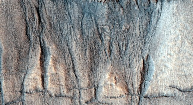 This observation from NASA's Mars Reconnaisance Orbiter captures details regarding the evolution of gully features observed in a crater in Acidalia Planitia.