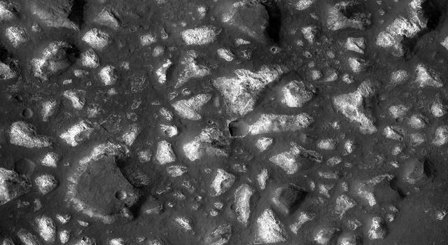 This image from NASA's Mars Reconnaisance Orbiter shows a portion of the Eridania region of southern Mars with fractured, dismembered blocks of deep-basin deposits that have been surrounded and partially buried by younger volcanic deposits.