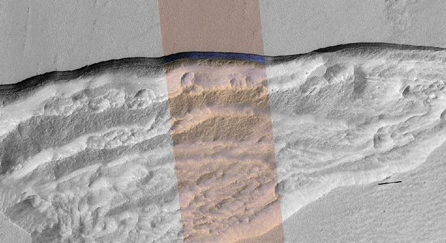 At this wedge-shaped pit on Mars, the steep slope (or scarp) at the northern edge exposes a cross-section of a thick sheet of underground water ice in this image from NASA's Mars Reconnaissance Orbiter.