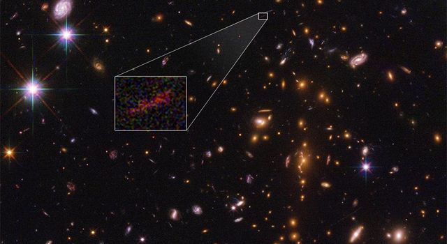NASA's Hubble Space Telescope shows the farthest galaxy yet seen in an image that has been stretched and amplified by a phenomenon called gravitational lensing.