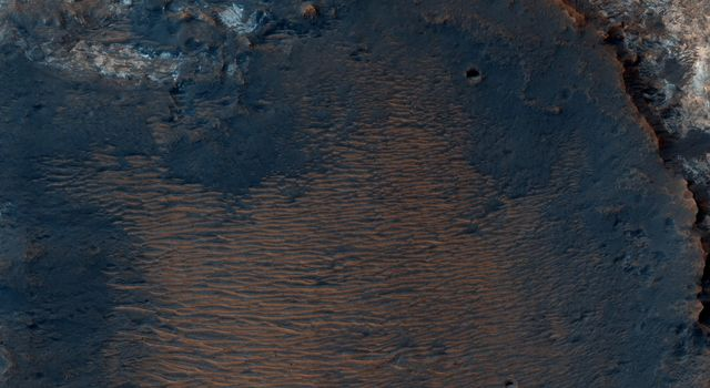 This image from NASA's Mars Reconnaissance Orbiter (MRO) captures details of an approximately 1-kilometer inverted crater west of Mawrth Vallis. Prolonged erosion removed less resistant rocks leaving behind other rocks.