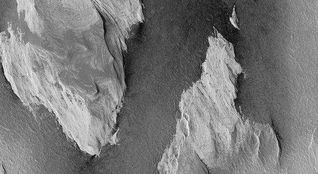 The prominent tear-shaped features in this image from NASA's Mars Reconnaissance Orbiter (MRO) are erosional features called yardangs. Yardangs are composed of sand grains that have clumped together.