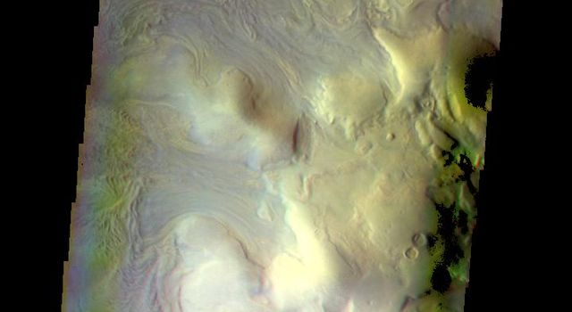 This false color image of Moreux Crater captured by NASA's 2001 Mars Odyssey spacecraft shows the highest elevations of the central peak, as well as the nearby sand dunes.