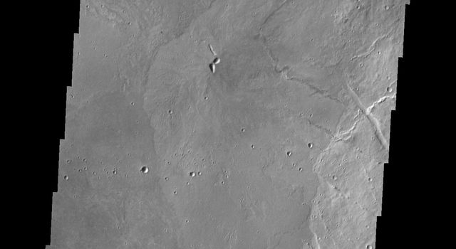 This image from NASA's 2001 Mars Odyssey spacecraft shows part of the caldera floor of Arsia Mons. Arsia Mons is the southernmost of the Tharsis volcanoes. It is 270 miles in diameter, almost 12 miles high, and the summit caldera is 72 miles wide.