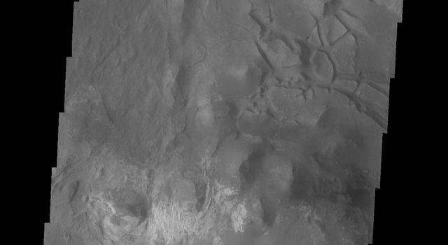 This image captured by NASA's 2001 Mars Odyssey spacecraft shows part of eastern Candor Chasma. At the top of the image is the steep cliff between the upper surface elevation and the depths of Candor Chasma.