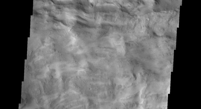 This image captured by NASA's 2001 Mars Odyssey spacecraft shows part of the border between Chandor and Melas Chasmata. The entire image is landslide deposits.