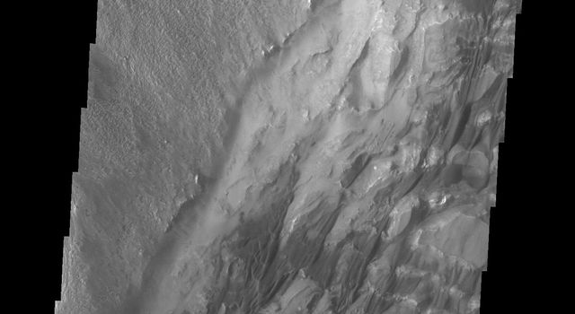 The bottom half of this image of central Candor Chasma from NASA's 2001 Mars Odyssey spacecraft shows a surface topography called chaos. Chaos is a region of small to medium sized mesas surrounded by valleys that are usually the same elevation.