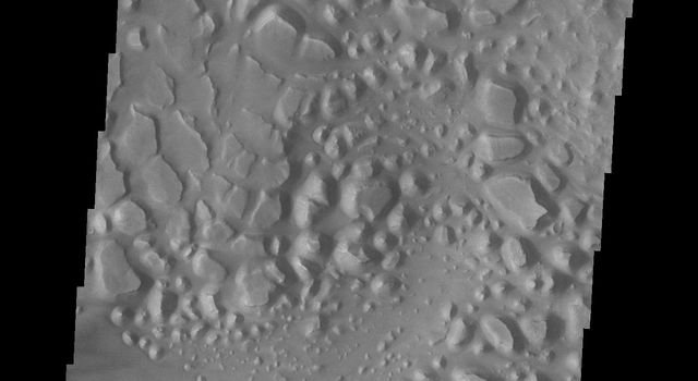 This image of central Candor Chasma captured by NASA's 2001 Mars Odyssey spacecraft shows a surface topography called chaos. Chaos is a region of small to medium sized mesas surrounded by valleys that are usually the same elevation.