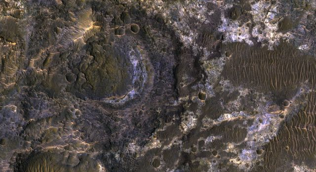Ladon Basin was a large impact structure that was filled in by the deposits from Ladon Valles, a major ancient river on Mars as seen in this image from NASA's Mars Reconnaissance Orbiter (MRO).