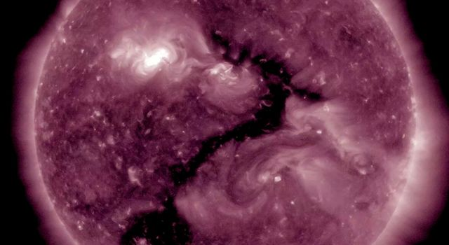 NASA's Solar Dynamics Observatory observed an elongated coronal hole (the darker area near the center) seeming to shape itself into a single, recognizable question mark over the period of one day (Dec. 21-22, 2017).