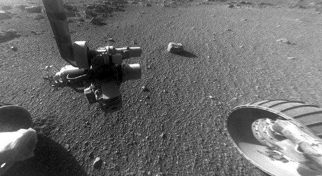 This late-afternoon view from the front Hazard Avoidance Camera on NASA's Mars Exploration Rover Opportunity shows a pattern of rock stripes on the ground, a surprise to scientists on the rover team.