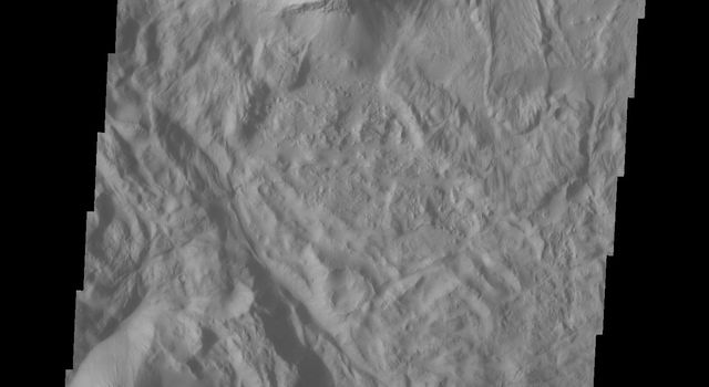 This image of Tithonium Chasma from NASA's 2001 Mars Odyssey spacecraft shows the canyon wall at the top of the frame and the cliff face of the opposite side of the canyon at the bottom of the image.