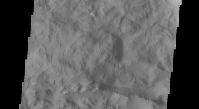 Continuing eastward along Ius Chasma, this image from NASA's 2001 Mars Odyssey spacecraft shows the eastern section of the large landslide deposit seen in yesterday's post. A landslide is a failure of slope due to gravity.