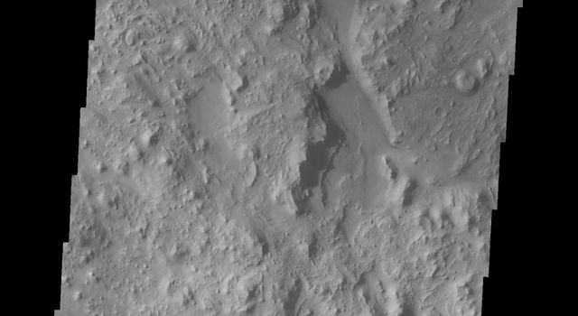 The bottom of this image captured by NASA's 2001 Mars Odyssey spacecraft shows the hills and mesas within the crater. The dunes at the top of the image are engulfing and covering the hills.