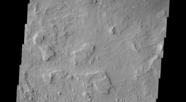 This image from NASA's 2001 Mars Odyssey spacecraft is located southeast of the region of the large sand dune deposit. Here there is still limited amounts of available sand and the dunes formed are smaller individual features.