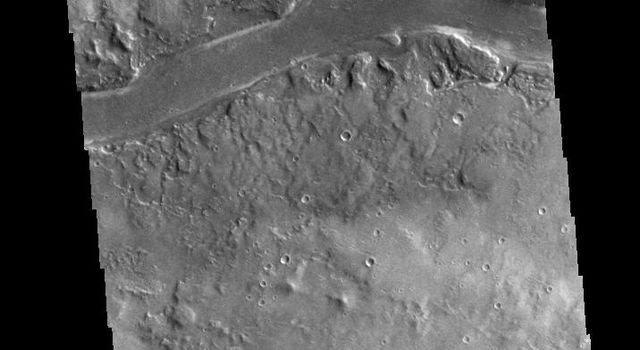 This image from NASA's 2001 Mars Odyssey spacecraft shows a section of Granicus Valles, one of several channel systems that originate near the western margin of the Elysium Mons volcanic complex.