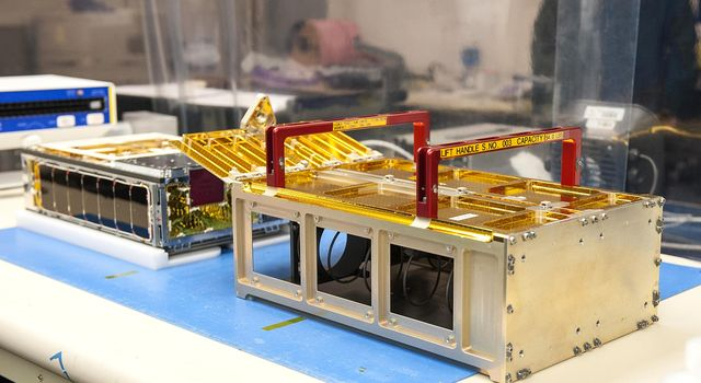 One of NASAs MarCO CubeSats inside a cleanroom at Cal Poly San Luis Obispo, before being placed into its deployment box.