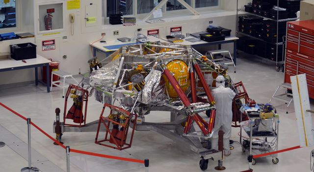 A technician works on the descent stage for NASA's Mars 2020 mission inside JPL's Spacecraft Assembly Facility. Mars 2020 is slated to carry NASA's next Mars rover to the Red Planet in July of 2020.