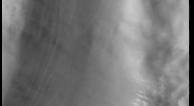This image captured by NASA's 2001 Mars Odyssey spacecraft shows 'streamers' of clouds created by katabatic winds at the north polar cap.