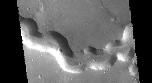 This image captured by NASA's 2001 Mars Odyssey spacecraft shows a section of Bahram Vallis. Bahram Vallis is located on the northeastern margin of Lunae Planum.