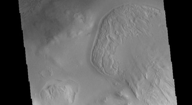 Lyot Crater is a large, complex crater in the northern lowlands of Vastitas Borealis. This image from NASA's 2001 Mars Odyssey spacecraft is located along the southern rim of the crater and shows part of the dune fields located on the floor of the crater.