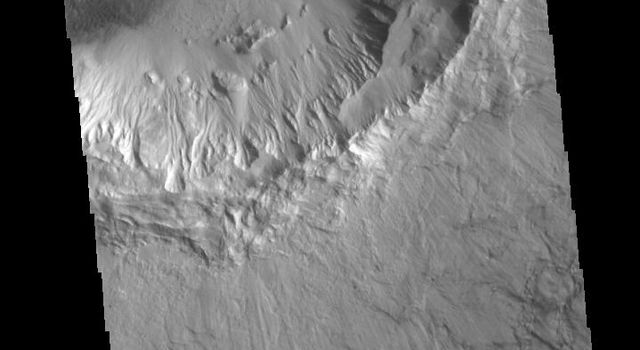 Bonestell Crater is a relatively young crater located in Acidalia Planitia. The grooved surface of the ejecta blanket is evident in this image from NASA's 2001 Mars Odyssey spacecraft.