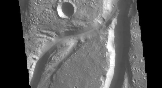 Osuga Valles is a complex set of channels located near Eos Chasma. This image was captured by NASA's 2001 Mars Odyssey spacecraft.
