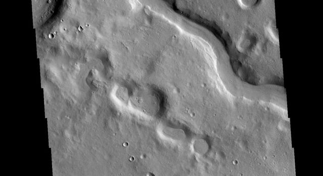 This image captured by NASA's 2001 Mars Odyssey spacecraft shows one of the numerous unnamed channels located in northern Arabia Terra.