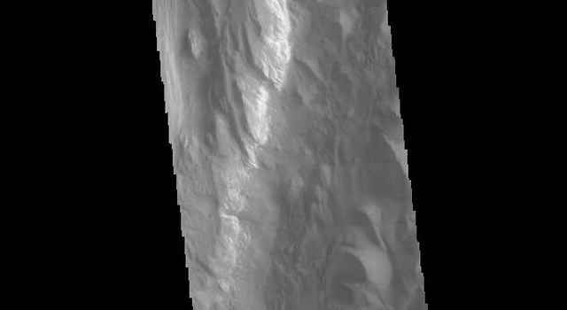 This image from NASA's 2001 Mars Odyssey spacecraft runs from northern Juventae Chasma to just short of the southern canyon wall.