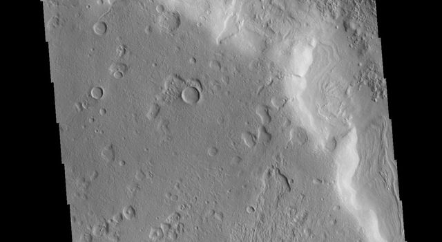 This image captured by NASA's 2001 Mars Odyssey spacecraft shows one of the numerous unnamed channels in northern Terra Sabaea.