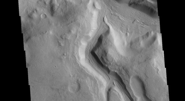 The northern margin of Terra Sabaea is a complex area between a cratered highland and complexly eroded lower plains. This image of the region captured by NASA's 2001 Mars Odyssey spacecraft shows just one of the numerous unnamed channels.