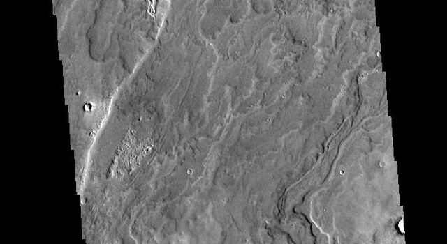 This image captured by NASA's 2001 Mars Odyssey spacecraft shows a small portion of the lava flows that comprise Daedalia Planum. The flows originated at Arsia Mons, the youngest of the three Tharsis volcanoes.