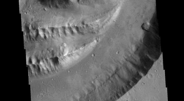 This image captured by NASA's 2001 Mars Odyssey spacecraft shows a section of Shalbatana Vallis. Shalbatana Vallis is located in Xanthe Terra.