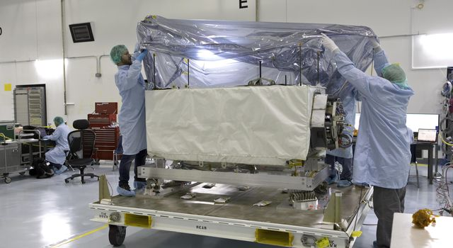 NASA's ECOsystem Spaceborne Thermal Radiometer Experiment on Space Station (ECOSTRESS) arrives at Kennedy Space Center in preparation for launch to the space station this summer.