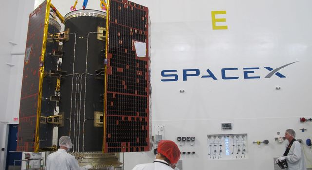 Technicians inspect NASA's twin GRACE Follow-On satellites and their multi-satellite dispenser at the SpaceX facility at Vandenberg Air Force Base in California.