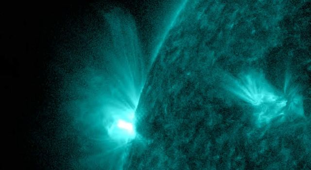 On May 23-25, 2018, NASA's Solar Dynamics Observatory observed an active region that rotated into view and sputtered with numerous small flares and towering magnetic field lines that stretched out many times the diameter of Earth.
