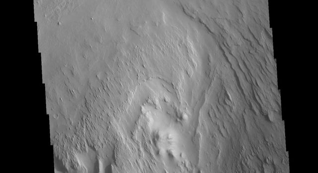 This image from NASA's Mars Odyssey shows linear ridges, the result of wind action eroding the material of a layered deposit.