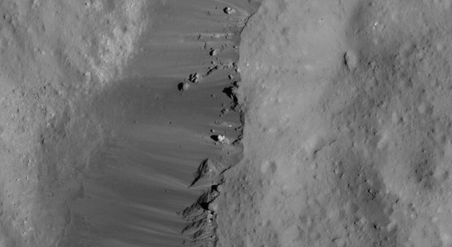 This image of Ceres' Occator Crater's eastern rim was obtained by NASA's Dawn spacecraft on June 9, 2018 from an altitude of about 30 miles (48 kilometers).