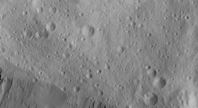 This image of the eastern rim of Occator Crater was obtained by NASA's Dawn spacecraft on June 10, 2018 from an altitude of about 22 miles (36 kilometers).