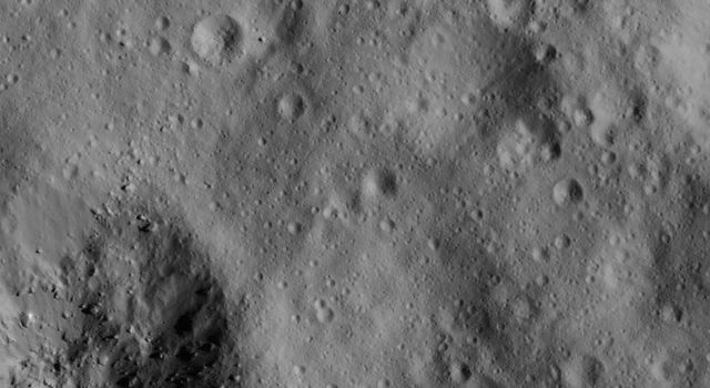 This image of a small boulder on Ceres was obtained by NASA's Dawn spacecraft on June 10, 2018 from an altitude of about 24 miles (38 kilometers).
