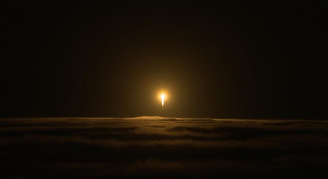 An Atlas V rocket carrying NASA's InSight lander breaks through cloud cover over Vandenberg Air Force Base on May 5, 2018.