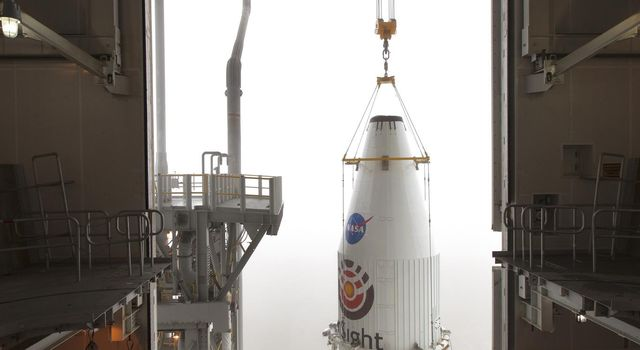 The payload fairing of the Atlas V rocket that would launch NASA's InSight lander to Mars is lifted up so that it can be mated to the top of the rocket.